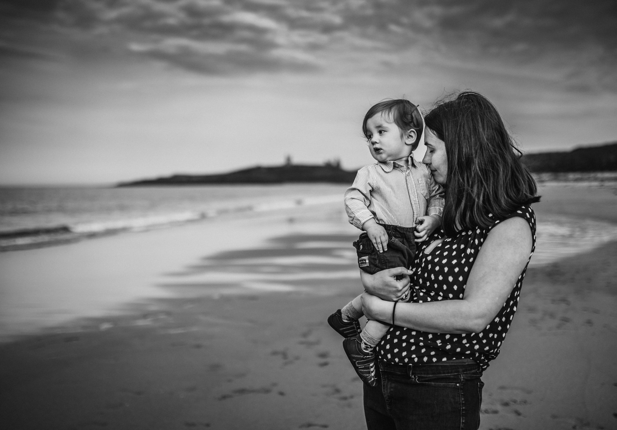 mother and baby at the beach northumberland