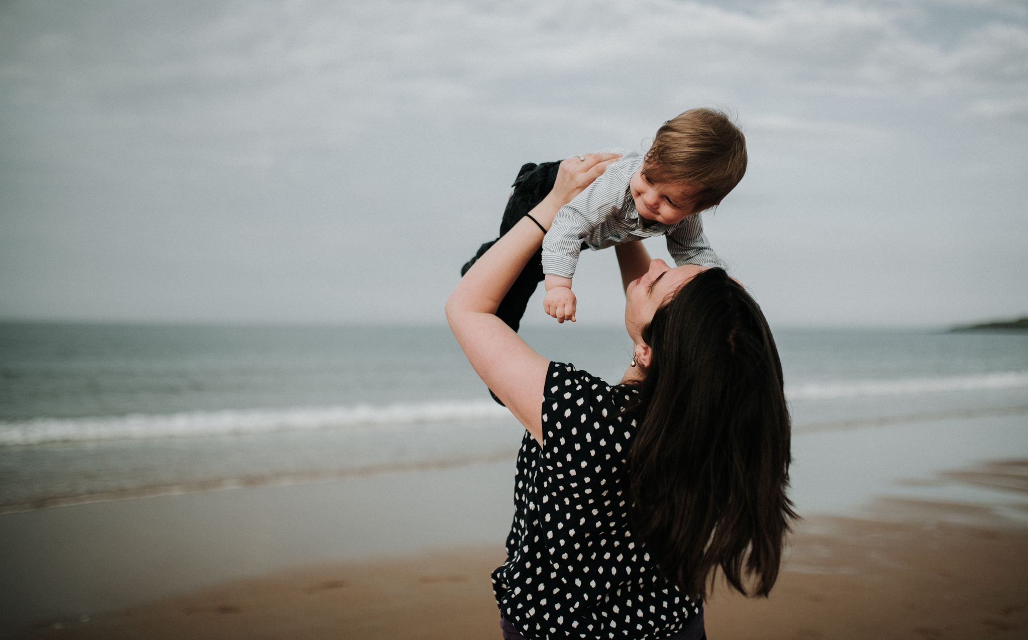 mother and baby boy at the beach