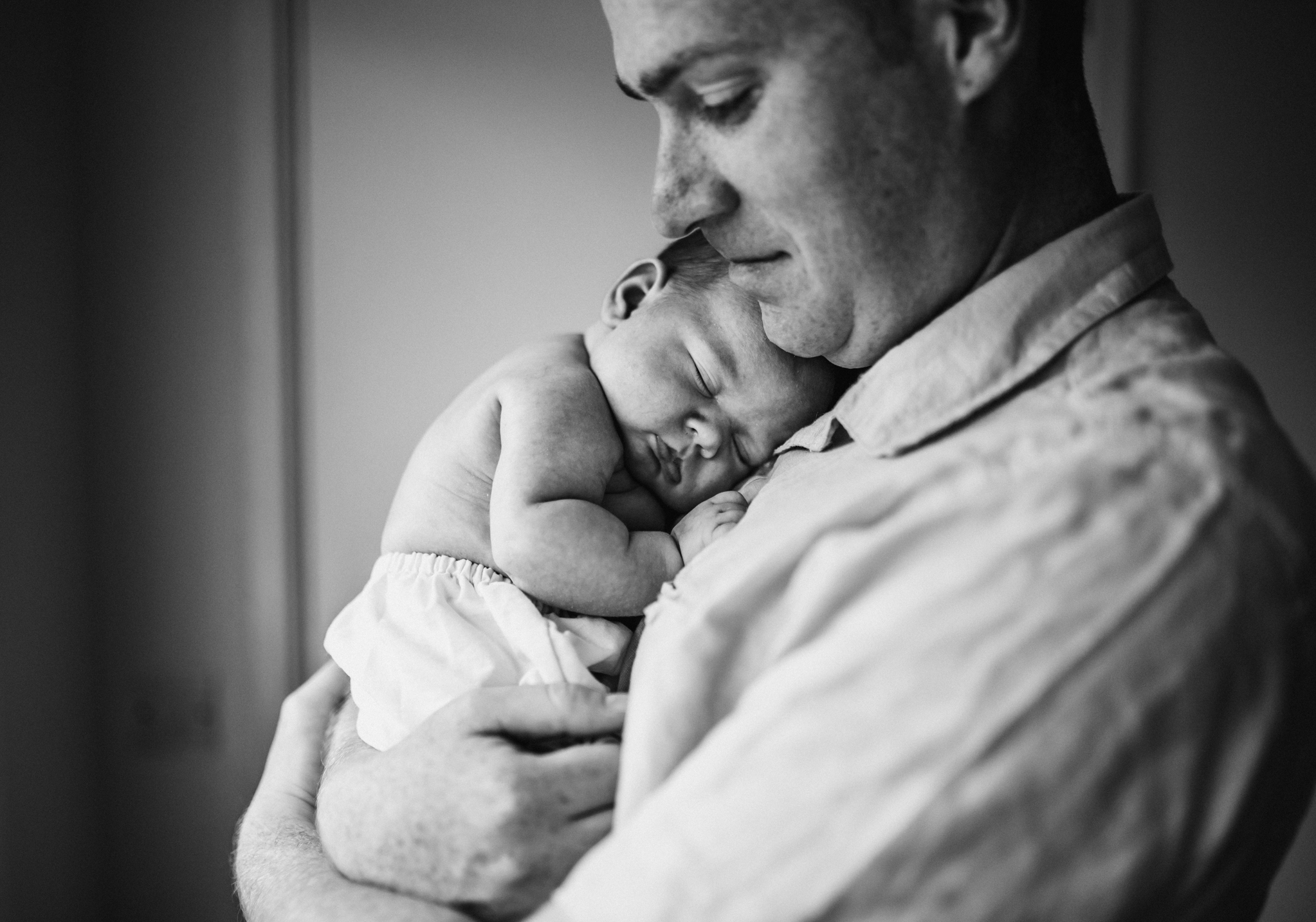 Dad with baby in arms