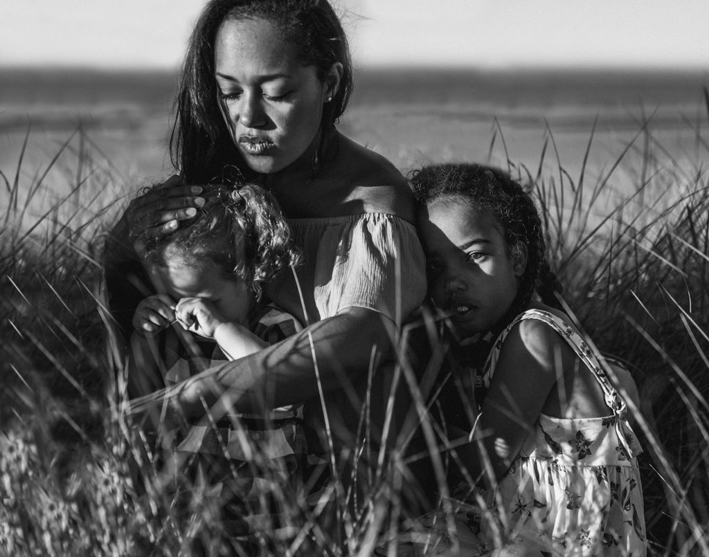 mother and children at the beach Family photographer north east
