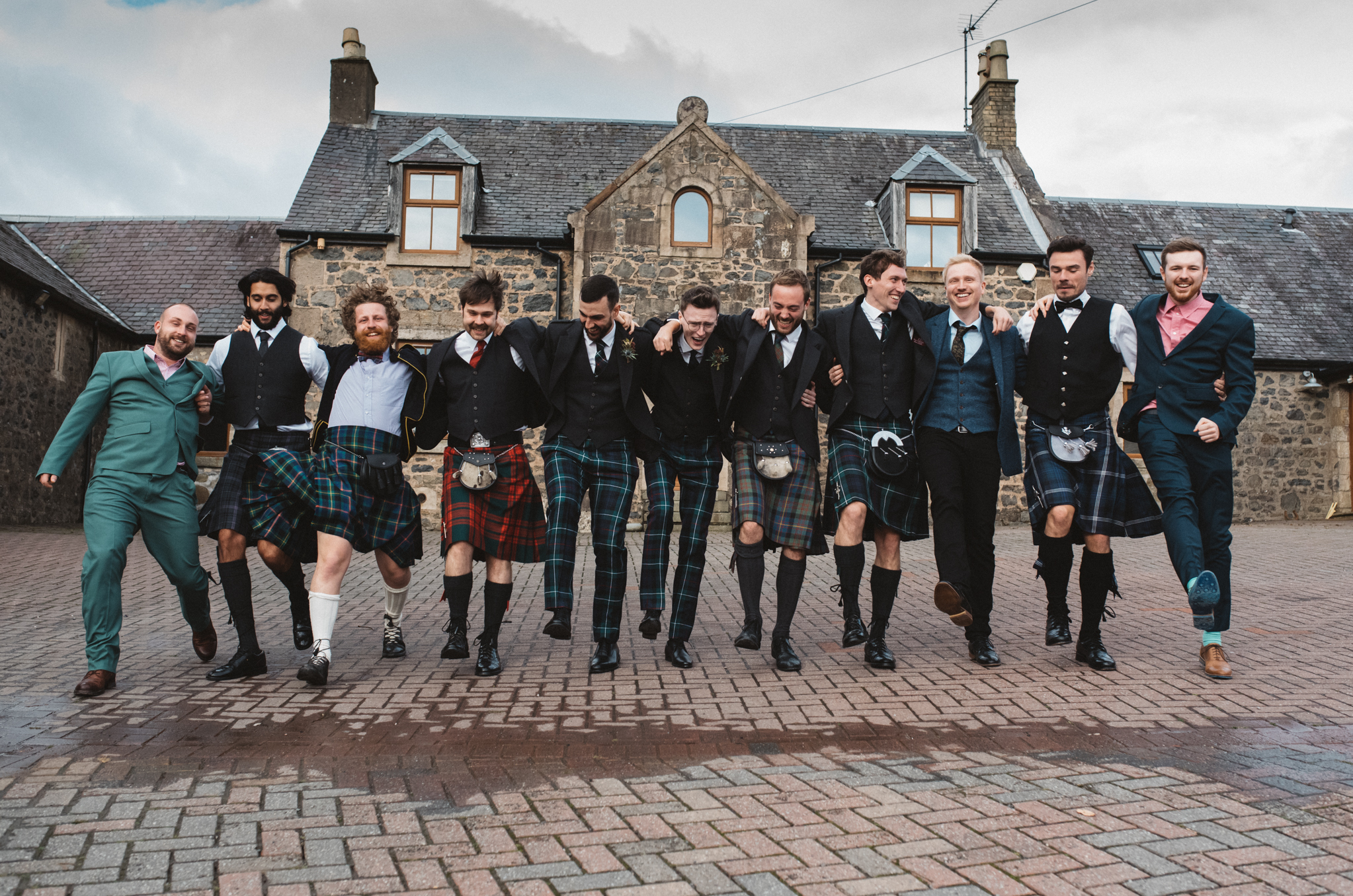 men in kilts at wedding in Glasgow