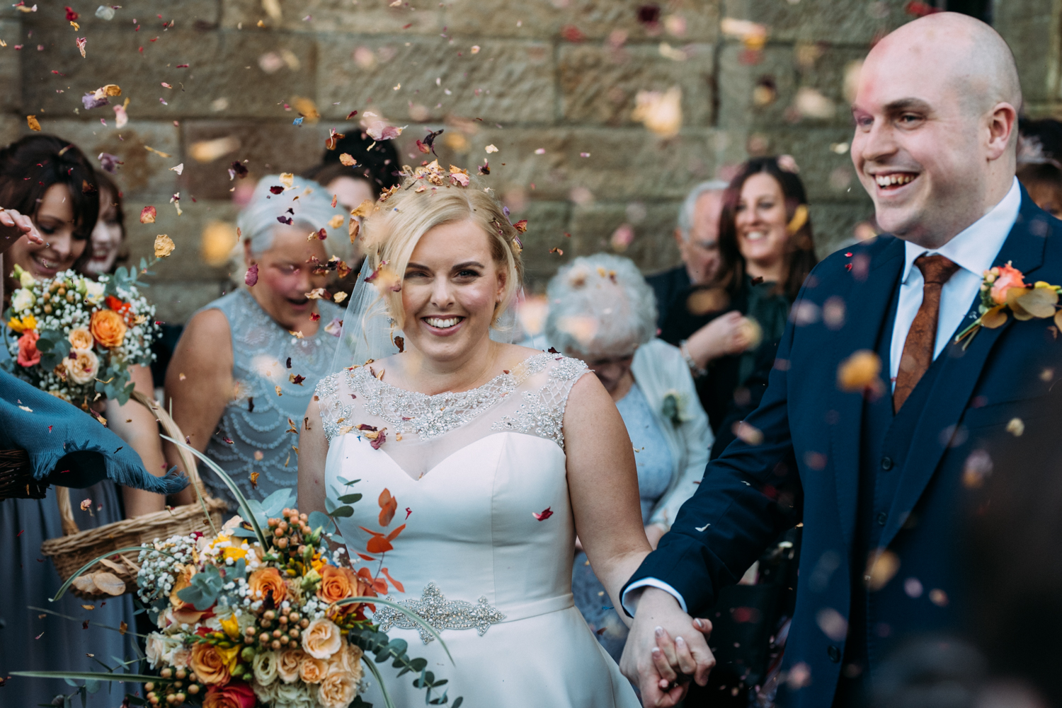 bride and groom in confetti at Shotton Grange Wedding