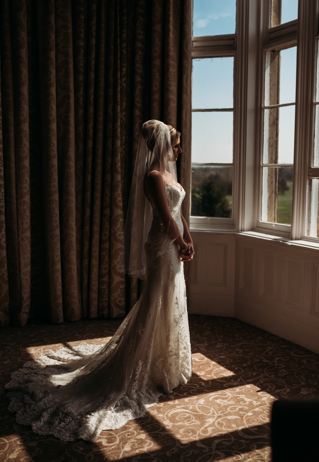 Bride getting ready at marten hall wedding photography northumberland