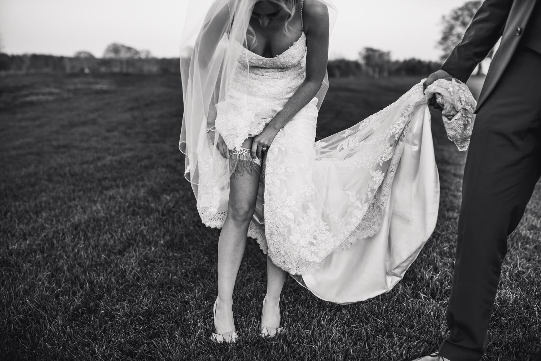 Bride adjust her wedding garter at Wedding at Maften Hall