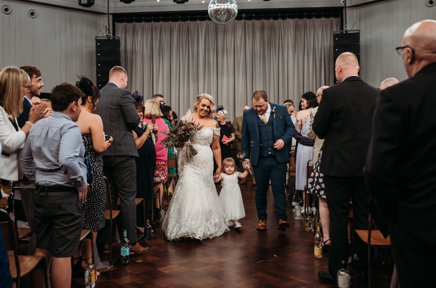 bride and groom and little girl walking down the aisle at Wylam Brewery Wedding