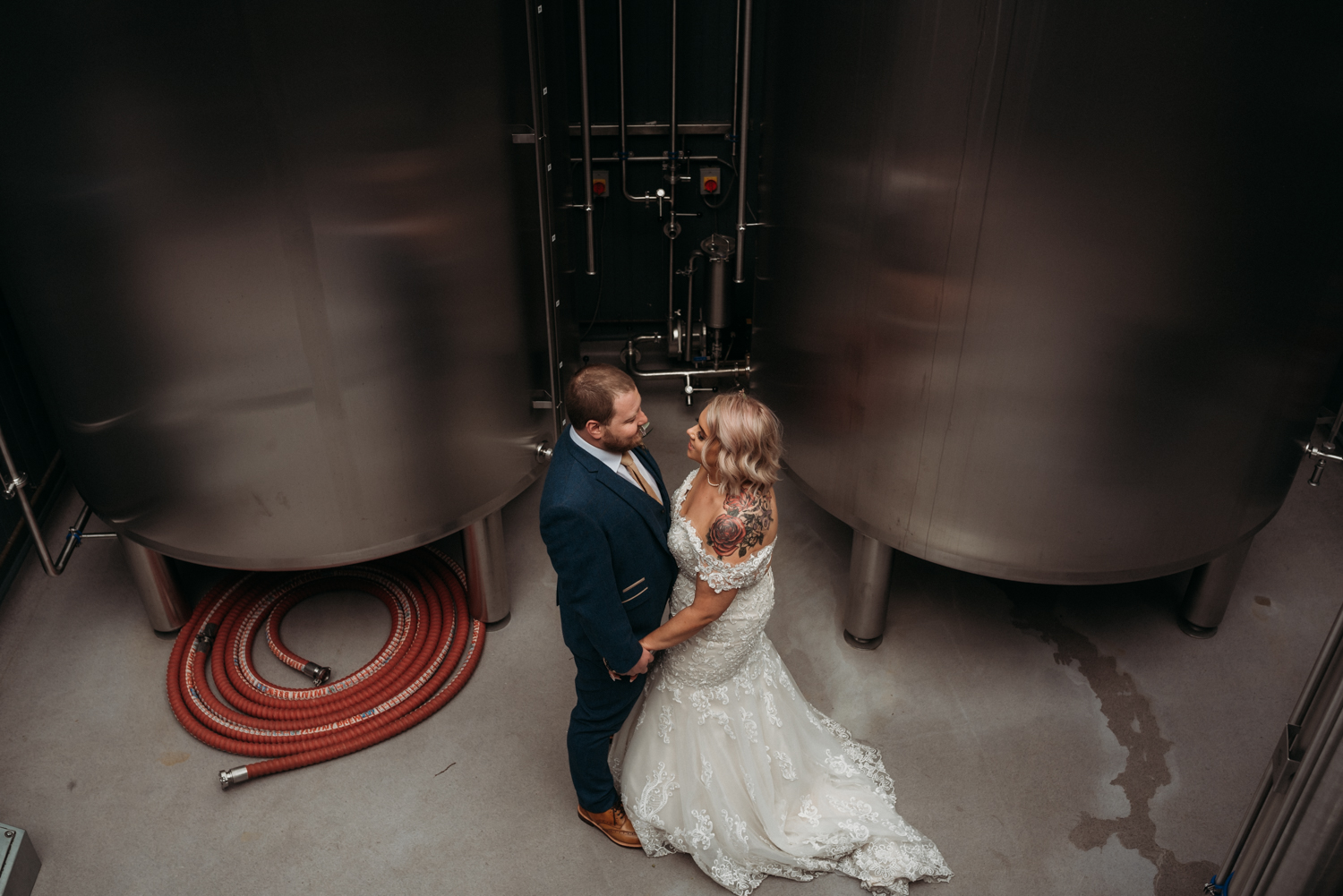 bride and groom in brewery at Wylam Brewery Wedding