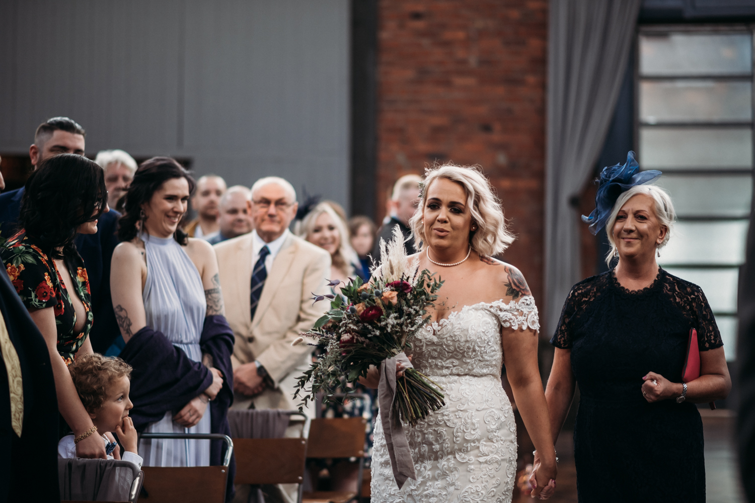 bride walking down the aisle with mother at Wylam Brewery Wedding