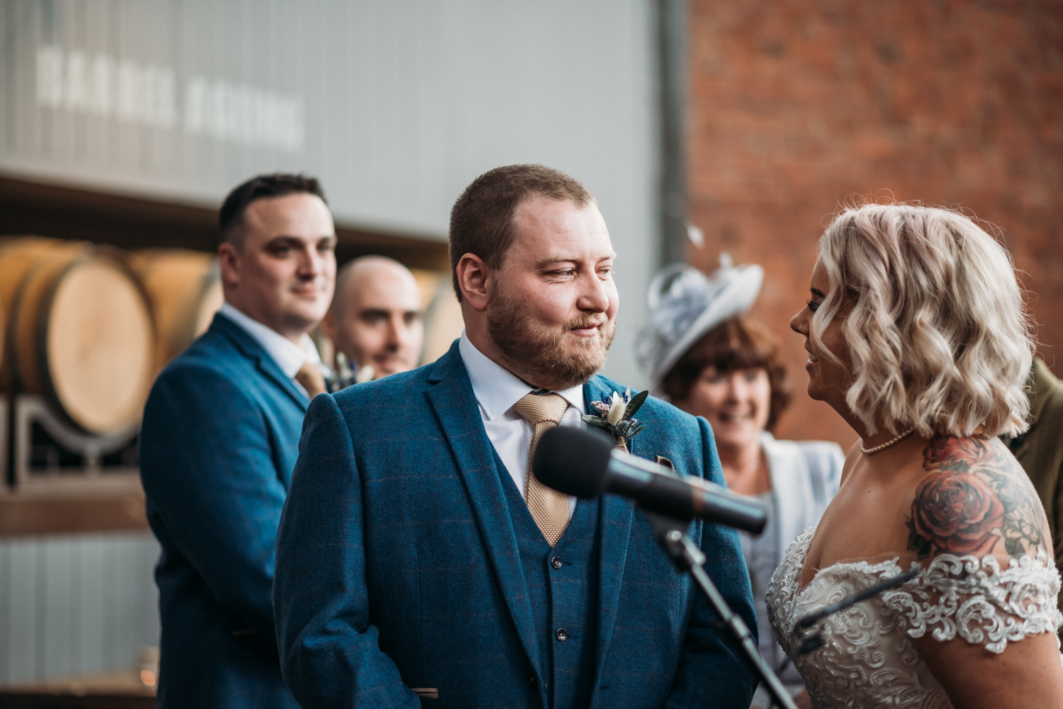 groom looking at bride during ceremony at Wylam Brewery Wedding