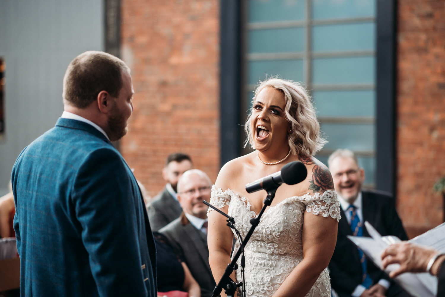 bride laughing during ceremony at Wylam Brewery Wedding