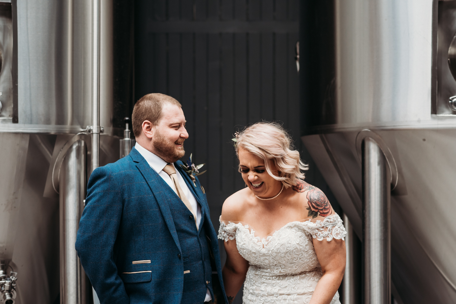 Bride and groom laughing at Wylam Brewery Wedding