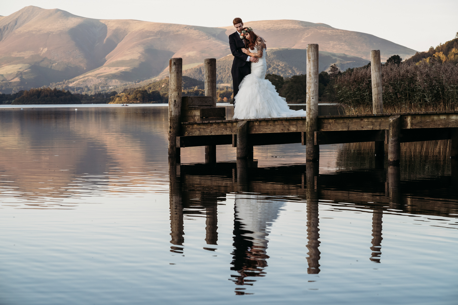 bride and groom on the peer at Lodore Falls Wedding