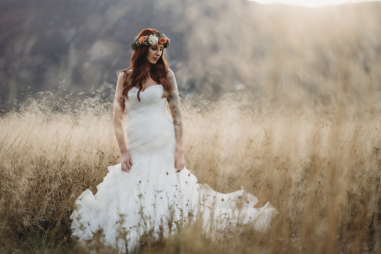 bride in golden grass at Lodore Falls Wedding