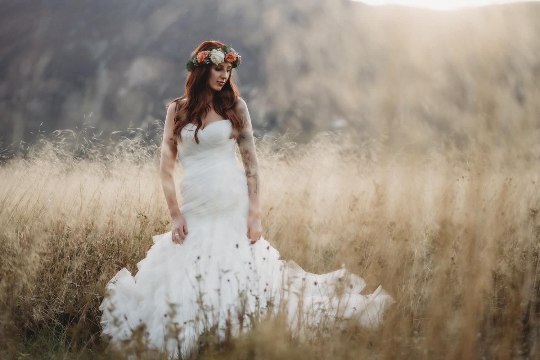 bride in golden grass at Lodore Falls Wedding