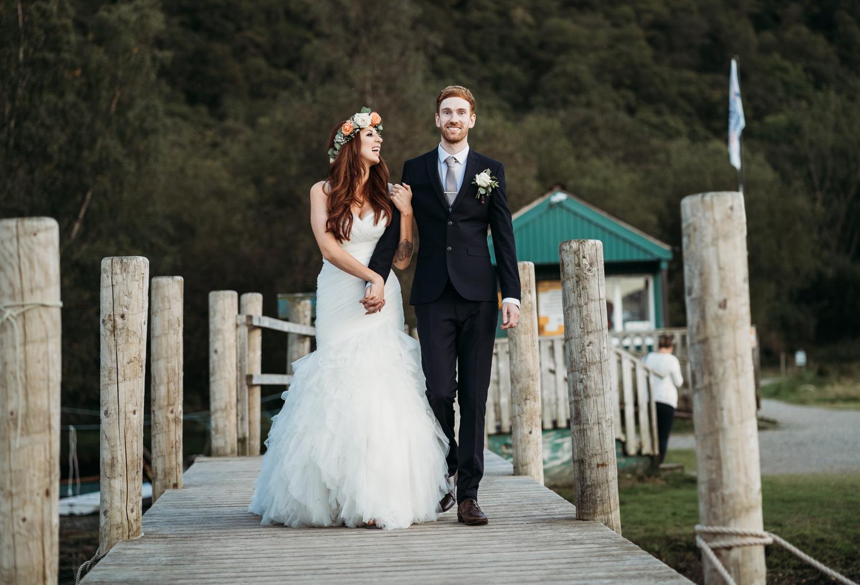 bride and groom walking on the peer at Lodore Falls Wedding